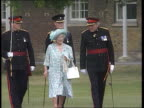 Queen Mother uses walking stick SKY West London MS Queen Mother along towards as accompanied by officers of the King's Regiment PULL OUT