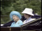 Queen Mother's 99th birthday LIB MS Queen mother along in carriage with Princess Anne