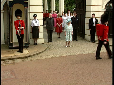Queen Mother's birthday ENGLAND London Clarence House TMS Queen Mother out to greet crowds with walking stick MS Ditto TMS Bandsmen marching past...