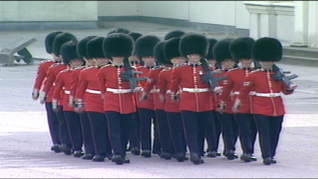 Queen mother's funeral arrivals Troops marching / More guests arriving at Abbey people to seats and seated / guests into abbey / Lord Carrington and...