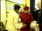 Queen no longer speaks Queen's English LIB INT Queen accepts cup of tea during visit to primary school NN