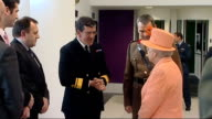 Queen opens new military headquarters Queen walks through doors then shakes hands with Navy officer then civilian staff / Queen talking with officers...