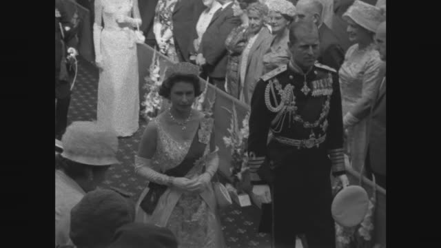 Queen opens New Zealand parliament NEW Wellington Shearing display flowers presented MCU Queen waves LS Shearing stand MS Closer ditto CU Shearing of...