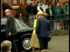 Queen praises Princes trust ITN London EXT Queen Elizabeth II from car and greeted by Prince of Wales on visit to housing development built by the...