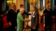 Queen reception for Praemium Imperiale award winners Queen into room doors opened and she receives guests at reception for recipients of the Praemium...