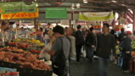 Queen Victoria Market time-lapse of shoppers and produce stalls in Melbourne.
