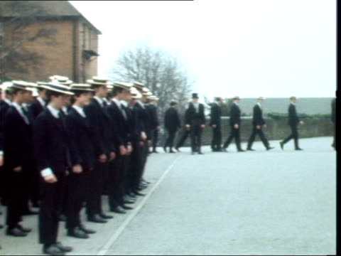 London Harrow School EXT Queen and Headmaster Dr James up school steps towards PAN passed boys lining steps Boys lined up for rollcall PAN as they...