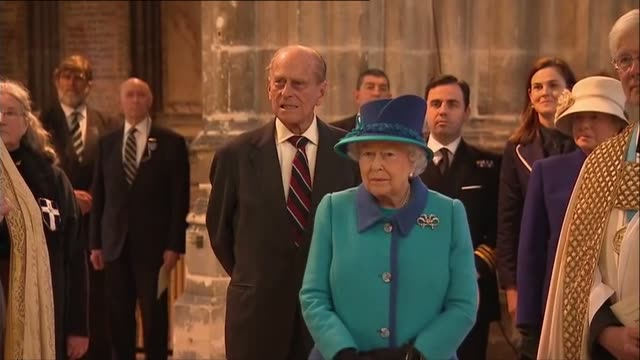 Queen visits Canterbury Cathedral INT **Music heard intermittently SOT** Clergyman chatting to Queen and Philip as along in Cathedral / Queen...