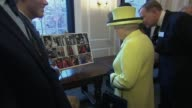 Queen visits Goodenough College Queen along chatting with various people and looking at photos / Guide dog / Queen meets children