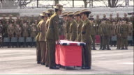 Queen visits Gurkha regiment in Maidstone Queen onto podium Troops marching on parade ground touching Union flag marching away then flag table is...