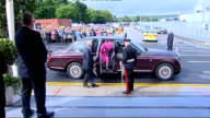 Greater Manchester Wigan Kitt Green THROUGHOUT*** Queen's car pulling up in front of cheering crowds / Queen Elizabeth out of car with Duke of...