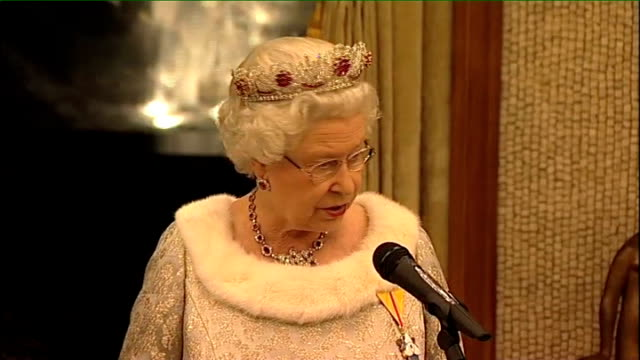 Queen visits Slovenia and wears recycled dress Queen Elizabeth as seated at State Banquet / Close up of Queen Elizabeth wearing a ruby and diamond...