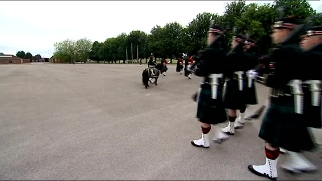 Queen visits The Argyll and Sutherland Highlanders at Howe Barracks and families in Canterbury BV Queen meeting troops and pony / military band...