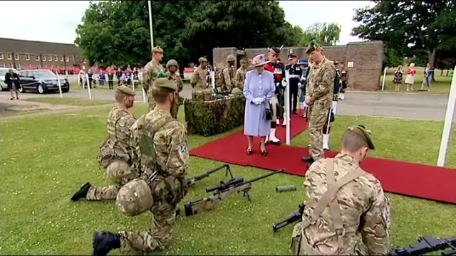 Queen visits The Argyll and Sutherland Highlanders at Howe Barracks and families in Canterbury EXT Weapons on display / Queen looking at display of...