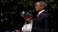 Queen welcomed at White House during royal visit Queen and George W Bush standing outside White House at official welcoming ceremony as British...