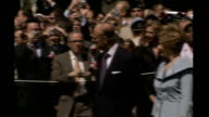 Queen welcomed at White House during royal visit USA Washington EXT Queen Elizabeth II and George W Bush walkingalong outside White House at official...