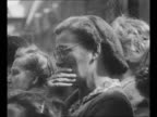Queen Wilhelmina and Princess Juliana exchange kisses after Wilhelmina reads statement of abdication in favor of Juliana from balcony of Royal Palace...