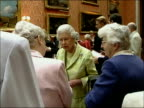 Queen's 80th birthday GVs at party for 99 fellow octogenarians ENGLAND London Buckingham Palace INT Queen Elizabeth II chatting to guests then walks...