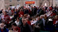 Queen's Diamond Jubilee Askrigg street party ENGLAND North Yorkshire Askrigg EXT Crowds at street party raise a toast to Queen Elizabeth and give...