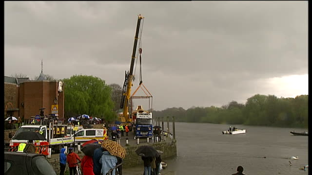 Queen's Diamond Jubilee Pageant Launch of lead boat 'Gloriana' ENGLAND Surrey Isleworth Crane along embankment of River Thames and crowd of onlookers...