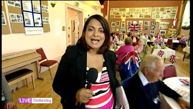 Queen's Diamond Jubilee Street parties and events across the country ENGLAND Yorkshire Stokesley INT Binger caller at Jubilee bingo event SOT...