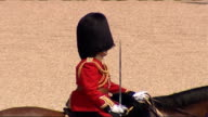 EXT Guardsman wearing bearskins on parade Queen and Duke of Edinburgh along in carriage