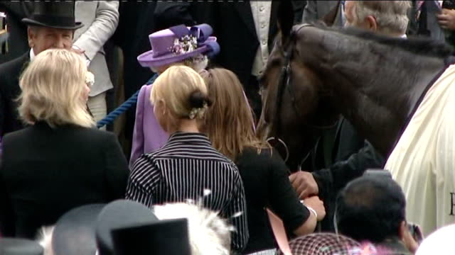 Queen's horse 'Estimate' wins Gold Cup Queen meets jockey Ryan Moore Ryan Moore riding horse Estimate into paddock to applause after winning Gold Cup...