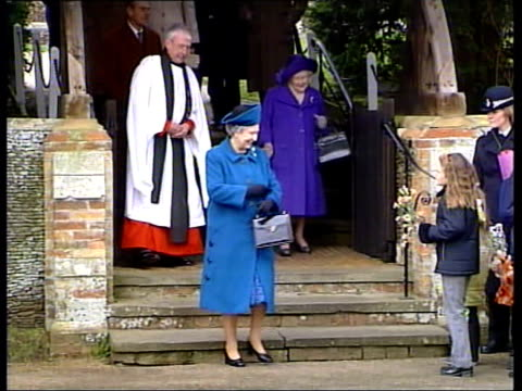 Queen's message Royals at Sandringham a2300 U'LAY Norfolk Sandringham EXT Queen Elizabeth II and the Queen Mother from church and receiving flowers