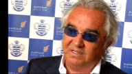 Flavio Briatore ENGLAND London INT QPR part owner Flavio Briatore posing with models wearing new team kit and air stewardesses frok new club sponsor...