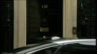 Queen's Speech David Cameron and Nick Clegg departures ENGLAND London Downing Street EXT Michael Gove MP departing No10 / David Cameron MP towards...