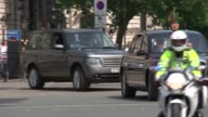 Queen's Speech Main ENGLAND London Whitehall EXT Bentley car along with Queen Elizabeth II and Prince Charles inside waving