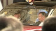 Queen's Speech Main Palace of Westminster EXT Queen Elizabeth accompanied by Prince Charles leaves Sovereign's Gate entrance by car following Queen's...