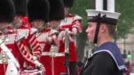 Queen's Speech Royal coaches ENGLAND London Westminster EXT Military marching band along through Parliament Square / Queen's guard in bearskin hats...