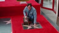 CHYRON Quentin Tarantino Honored with Star on the Hollywood Walk of Fame at Hollywood Walk Of Fame on December 21 2015 in Hollywood California