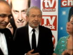 Arrivals and winners interviewed Camera pans to as Alan Sugar along behind to join dragons Sir Alan Sugar interview SOT Talk of cameo appearance on...