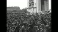 [8/29/44] Quick shot military parade down ChampsElysees with row of jeeps military journalist with movie camera in street crowds to the sides can see...