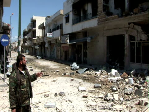 Qusayr Syria the rebels still control half of the city despite battles and shelling that have caused a lot of damageShelled mosqueTaj a rebel...