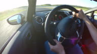 Race car drivers point of view racing and shifting gear