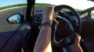 Race car drivers point of view while racing, shifting gear