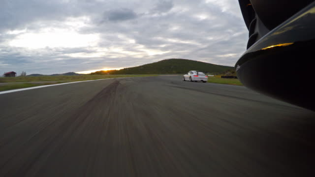Race car driving while another sports car is overtaking