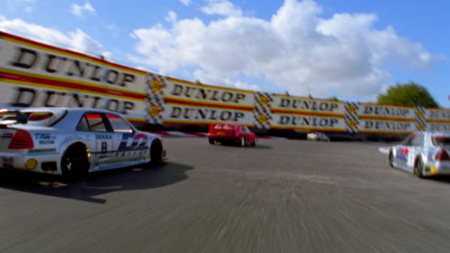 Race car point of view with cars racing on track / crashing at end (remote control cars)
