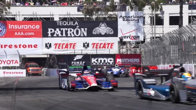 Racers get prepared before the start of the Toyota Grand Prix of Long Beach on the streets of Long Beach California on April 19 2015 Scott Dixon of...
