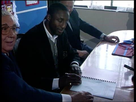 Background LIB ENGLAND Birmingham INT John Fashanu at press conference signing to Aston Villa John Fashanu and Ron Atkinson posing with Aston Villa...