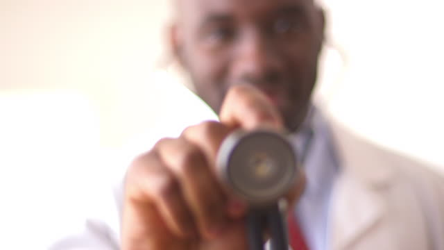 Rack focus between stethoscope and doctor