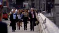 rack focus businesspeople walking on London Bridge / London, England