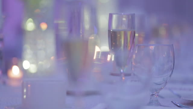 Rack focus, champagne glasses at a wedding reception
