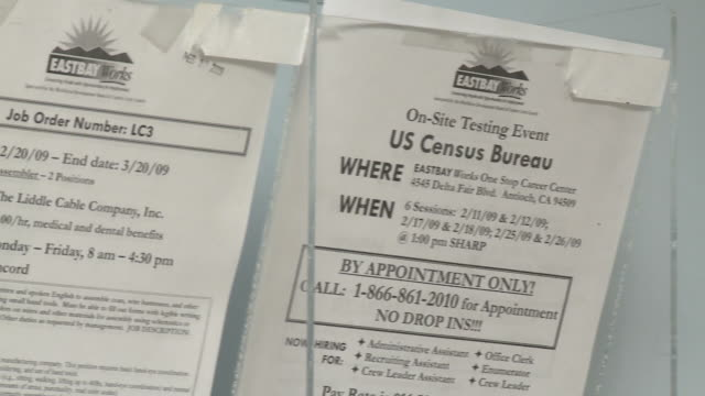 Rack of job listings on wall in job center/ Antioch California USA/ AUDIO