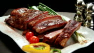 Rack of ribs on platter with amenities. Left Rotation.