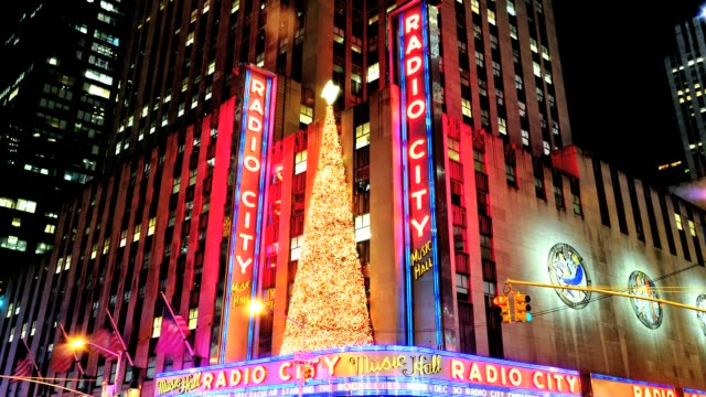 LAPSE Radio City Music Hall entertainment venue Avenue of the Americas Midtown Manhattan New York City USA Radio City decorated with Christmas tree...