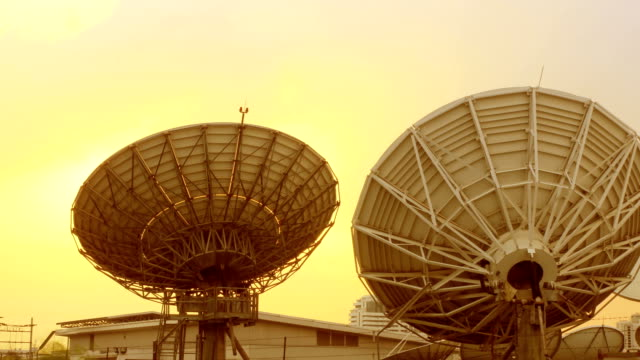 Radio telescope in evening at sunset, time lapse